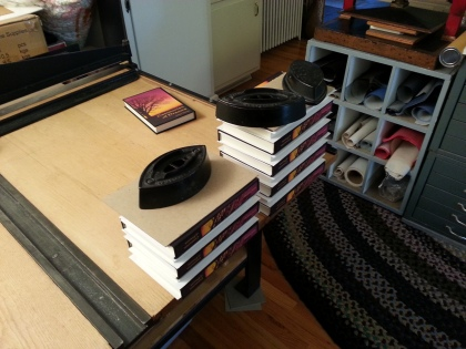 Finished books, stacked and drying.